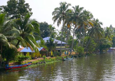 Boats and houses on the Allepey backwaters Kerala India