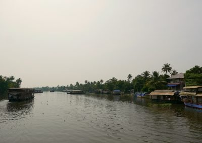 Allepey backwaters rice barges and houses Kerala India