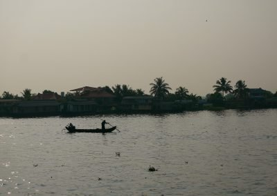 Two Fishermen on a boat Allepey backwaters Kerala India