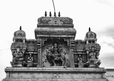 Carvings on the entrance to a Chettinad mansion in Black and white