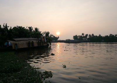 Houseboat in the sunset Alappuzha backwaters Keralal India