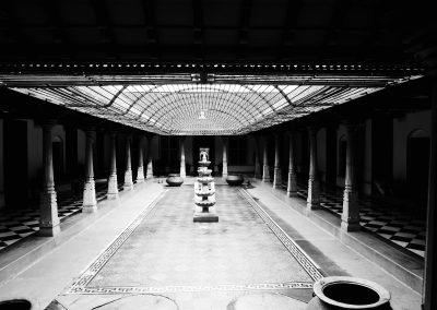 Inside courtyard of a Chettinad mansion in black and white