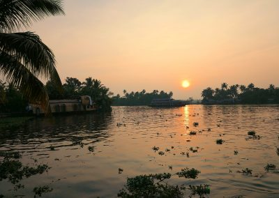 Sunset houseboat and houseboats on the backwaters Alappuzha India