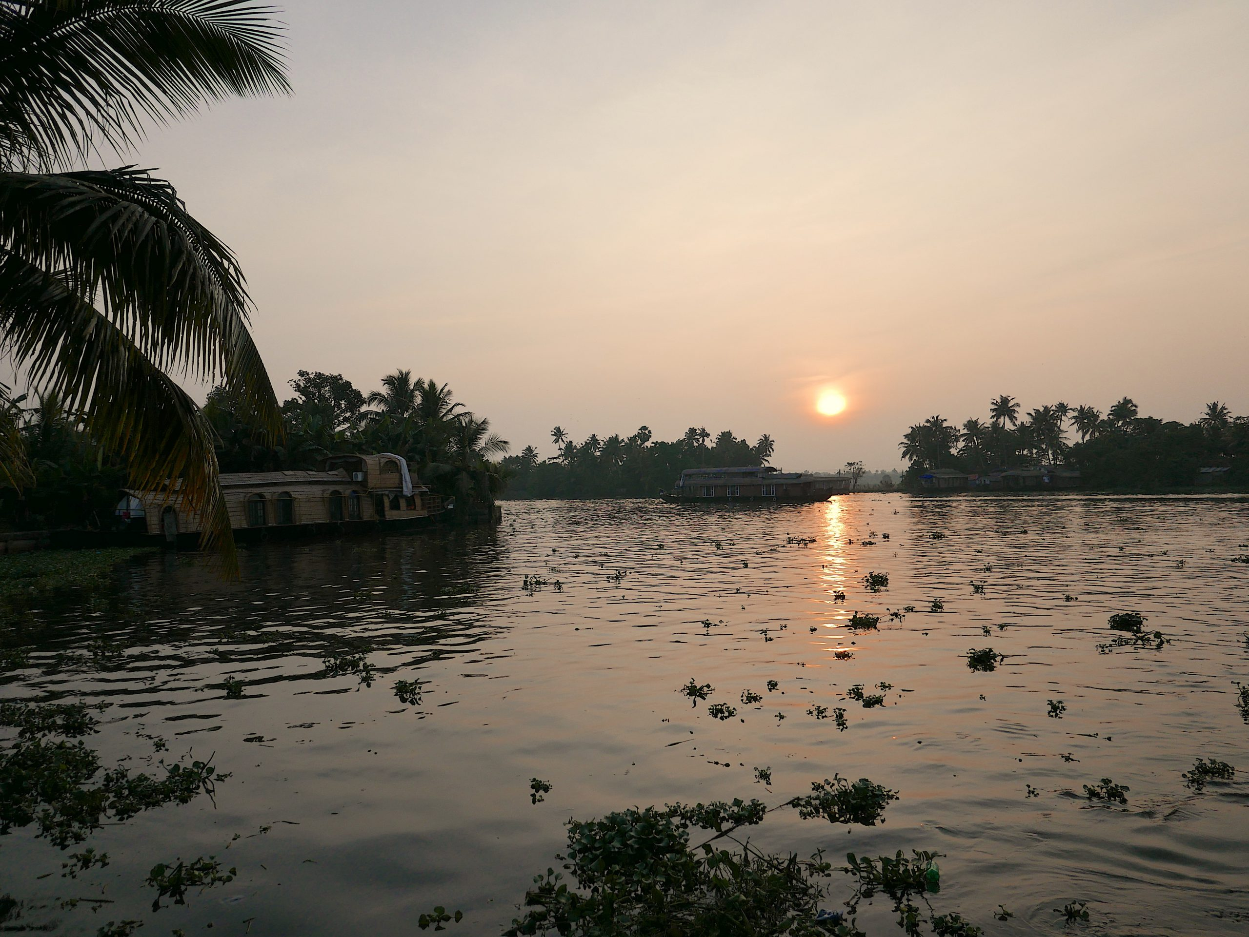 Sunset and houseboat Alappuzha