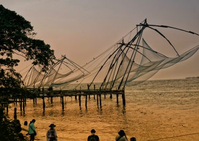 Chinese fishing nets with peoplewatching Fort Kochi