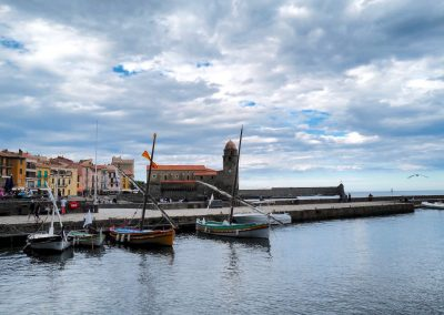 Anchovy boats and clock tower Collioure